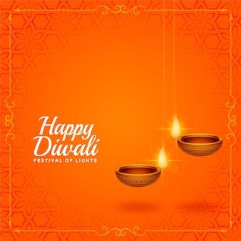 Glücklicher diwali orange gruß mit hängendem diya