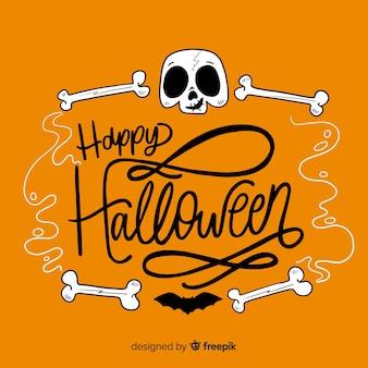 Glücklicher halloween-beschriftungshintergrund mit dem schädel und den knochen