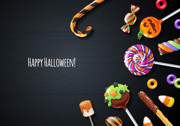 Glücklicher halloween-hintergrund mit bunten süßigkeiten