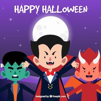 Glücklicher halloween-hintergrund mit kindern in der verkleidung