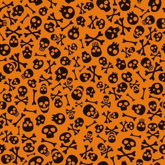 Glücklicher halloween-hintergrund mit schädel und knochen. nahtloses halloween-muster.