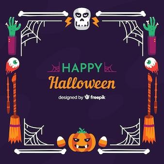 Glücklicher halloween-schädel und kürbisrahmen