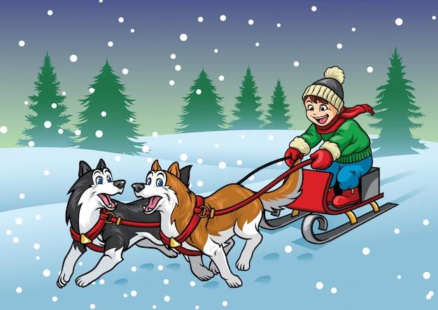 Glücklicher junge, der den schlitten mit huskieshunden reitet
