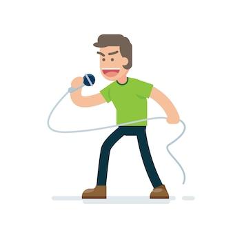 Glücklicher junger gutaussehender mann, der mit mikrofon singt