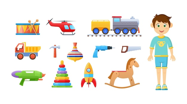 Glücklicher kinderjunge mit kindischem spielzeugset. kinderspielzeug trommel, eisenbahn, zug, hubschrauber, lkw