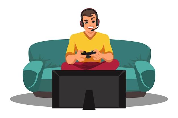 Glücklicher lächelnder spieler, der headset trägt, das videospiel mit joystick spielt, der vor fernsehen sitzt