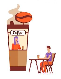 Glücklicher mann, der auf faust-datum nahe kaffee-kiosk wartet