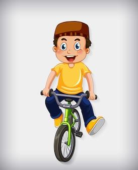 Glücklicher muslimischer junge, der fahrrad fährt