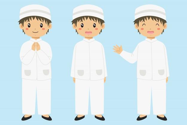 Glücklicher muslimischer junge, der hand lächelt und winkt. zeichensatz für muslimische kinder.