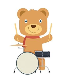 Glücklicher netter brauner teddybär, der trommel spielt