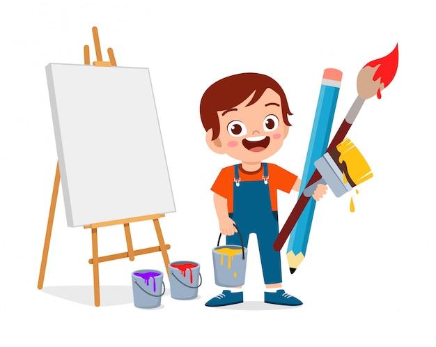 Glücklicher niedlicher kleiner kinderjunge malt künstler