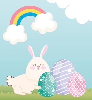 Glücklicher oster entzückender hase mit eiern grasregenbogenwolken