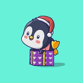 Glücklicher pinguin mit geschenkbox lokalisiert auf grün