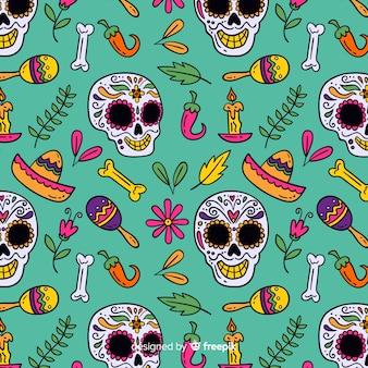 Glücklicher schädel und mexikanische elemente übergeben gezogenes muster día de muertos