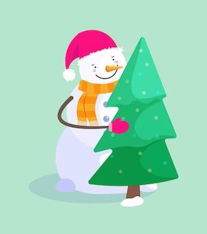 Glücklicher schneemann in der weihnachtsmütze mit tannenbaum auf grünem hintergrund