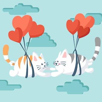 Glücklicher valentinstag der paarkatze, die mit einem fallschirm fliegt