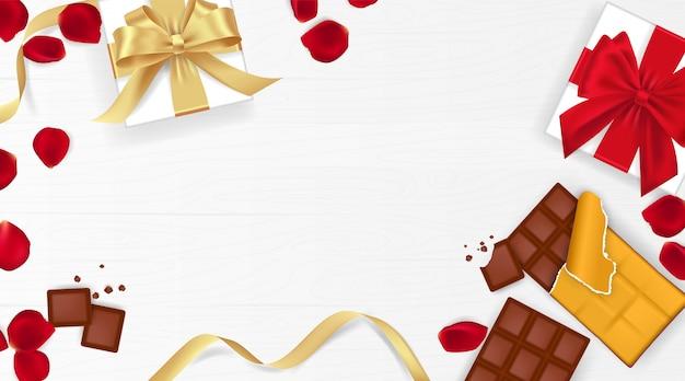 Glücklicher valentinstag hintergrund mit rosenblättern, schokolade und geschenkbox