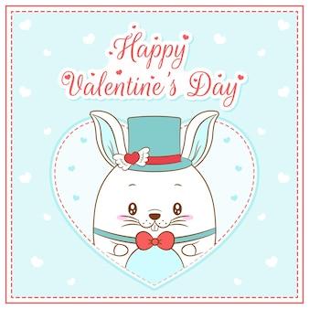 Glücklicher valentinstag niedlicher hase junge, der postkarte großes herz zeichnet