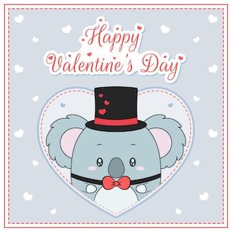 Glücklicher valentinstag niedlicher koalaknabe, der postkarte großes herz zeichnet