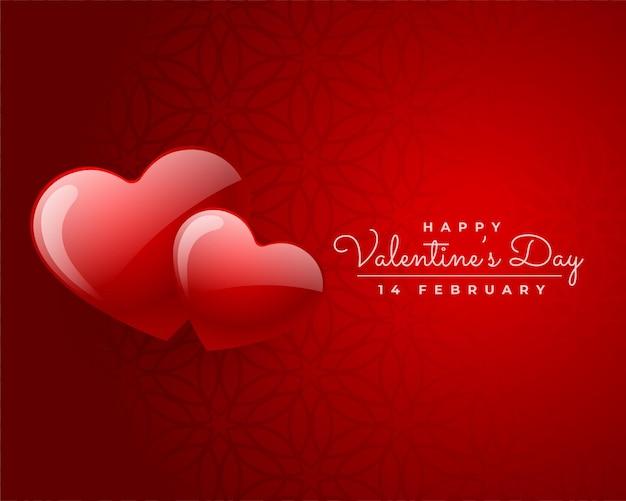 Glücklicher valentinstag zwei rote herzen lieben kartenentwurf