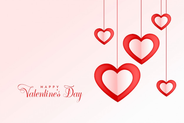 Glücklicher valentinstaghintergrund der reizenden hängenden herzen