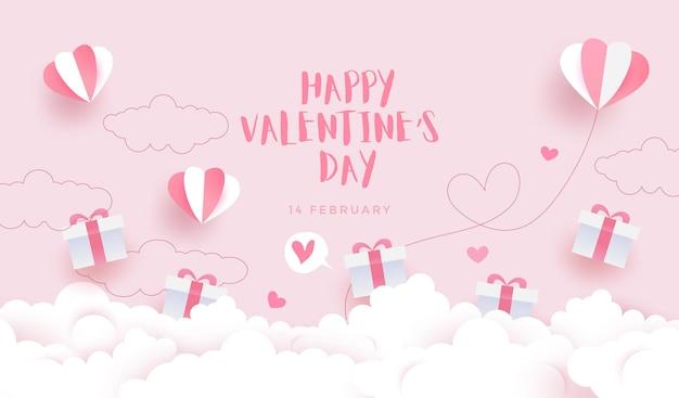 Glücklicher valentinstaghintergrund, karteneinladung mit reizenden geschenkboxen, wolken und herzballons auf pastellrosa hintergrund.