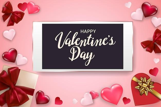 Glücklicher valentinstaghintergrund mit smartphone, geschenkbox, herzen und schleifen.