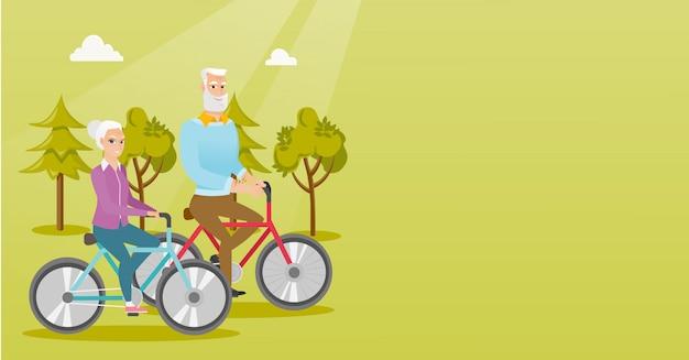 Glückliches älteres paarreiten auf fahrrädern im park.