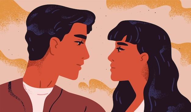 Glückliches entzückendes paar in der liebe. porträt des jungen mannes und der frau, die einander betrachten. paar romantische partner am date. freund und freundin