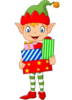 Glückliches grünes elfenjungenkostüm, das geburtstagsgeschenke hält