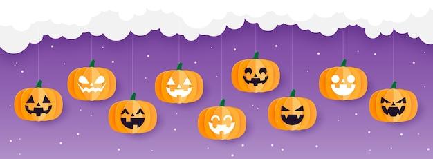 Glückliches halloween-banner oder halloween-hintergrund mit halloween-kürbissen, die auf der wolke hängen, papierkunststil.