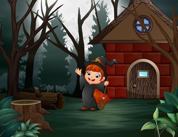Glückliches halloween-hexenkostüm auf der homepage
