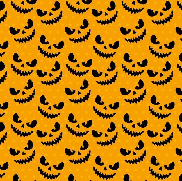 Glückliches halloween nahtloses muster mit gruseligen gesichtern