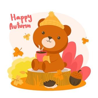 Glückliches herbst mit einem bären, der auf einem stumpf sitzt, der kaffee trinkt