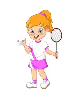 Glückliches kleines mädchen, das badminton spielt