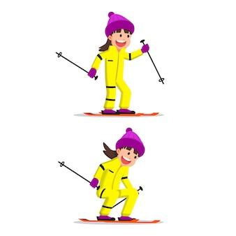 Glückliches kleines mädchen skifahren in winterkleidung