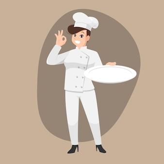 Glückliches kochkarikaturporträt des jungen großen kerlkochs, der hut und kochuniform trägt, halten leeres gericht