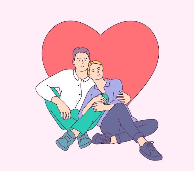 Glückliches lächelndes junges paar, das am valentinstag umarmt.