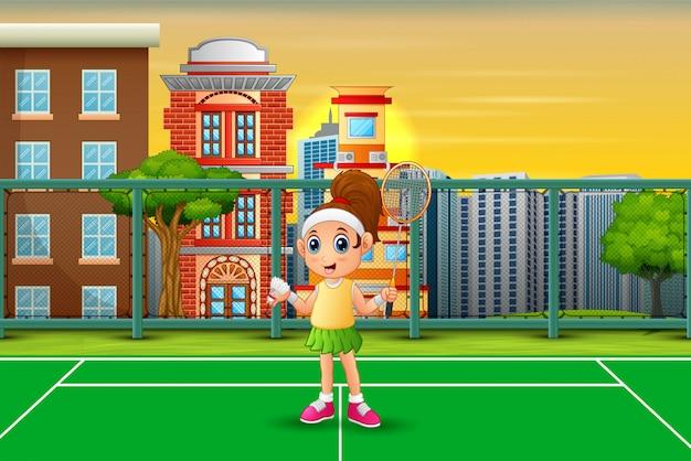 Glückliches mädchen, das badminton am gericht spielt