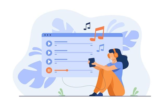 Glückliches mädchen, das kopfhörer trägt, wiedergabeliste genießt, musik auf handy hört, lieder singt