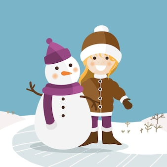 Glückliches mädchen mit ihrem schneemann an einem sonnigen wintertag