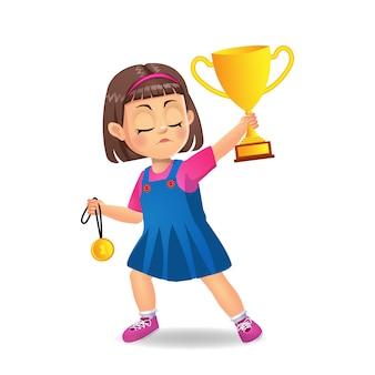 Glückliches mädchenkind mit trophäenbecher und medaille