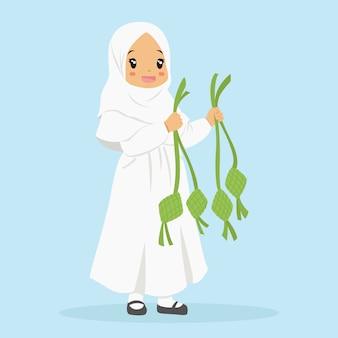 Glückliches muslimisches mädchen, das ketupat hält. zeichentrickfigur der muslimischen kinder