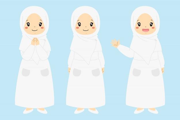 Glückliches muslimisches mädchen lächelnd und winkende hand. muslimische kinder charakter r gesetzt. Premium Vektoren