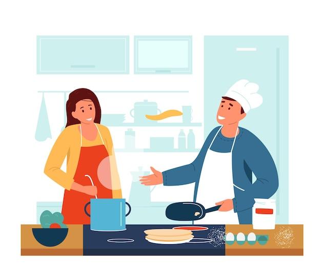 Glückliches paar, das zusammen in der küche kocht.
