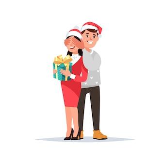 Glückliches paar feier weihnachten urlaub guy gibt mädchen geschenk überraschung