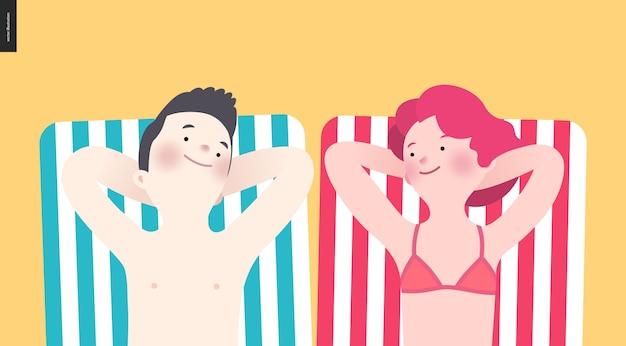 Glückliches paar, sonnenbaden am strand