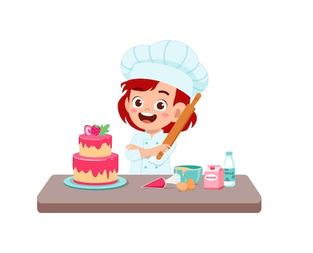 Glückliches süßes kleines kindermädchen tragen kochuniform und kocht eine geburtstagstorte