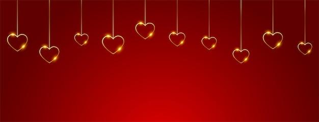 Glückliches valentinstagbanner mit hängenden goldenen herzen