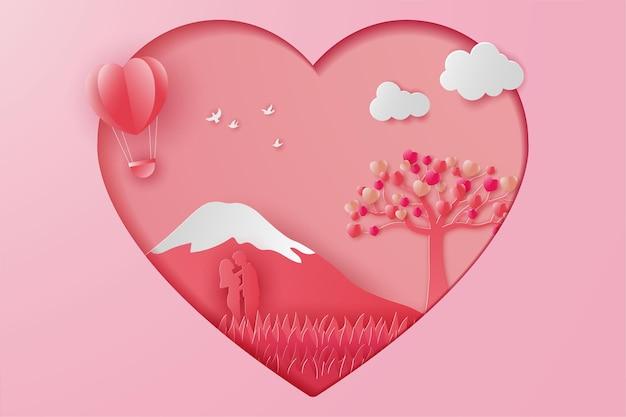 Glückliches valentinstagillustrationspaar liebt mit bergen, ballon und feldgras, papierschnittart.